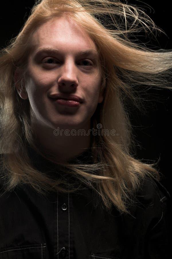 Download Jonge Mens Met Lang Blond Haar Stock Foto - Afbeelding bestaande uit smiling, portret: 10784222