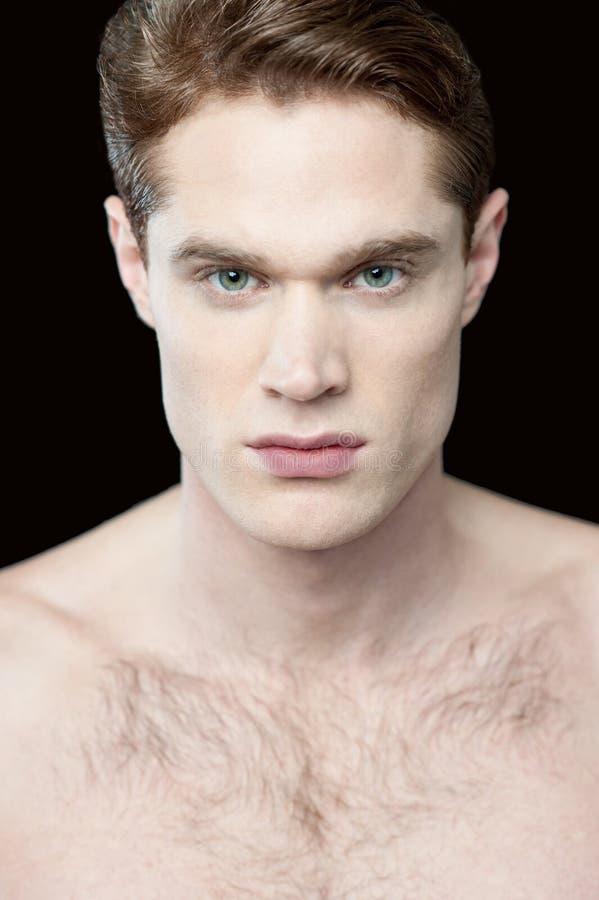 Jonge mens met naakt-chested stock foto's