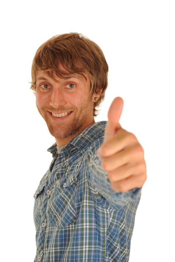 Jonge mens met omhoog duim stock fotografie