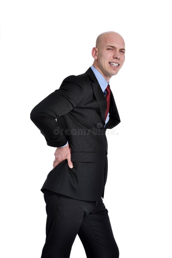 Jonge mens met rugpijn stock afbeelding