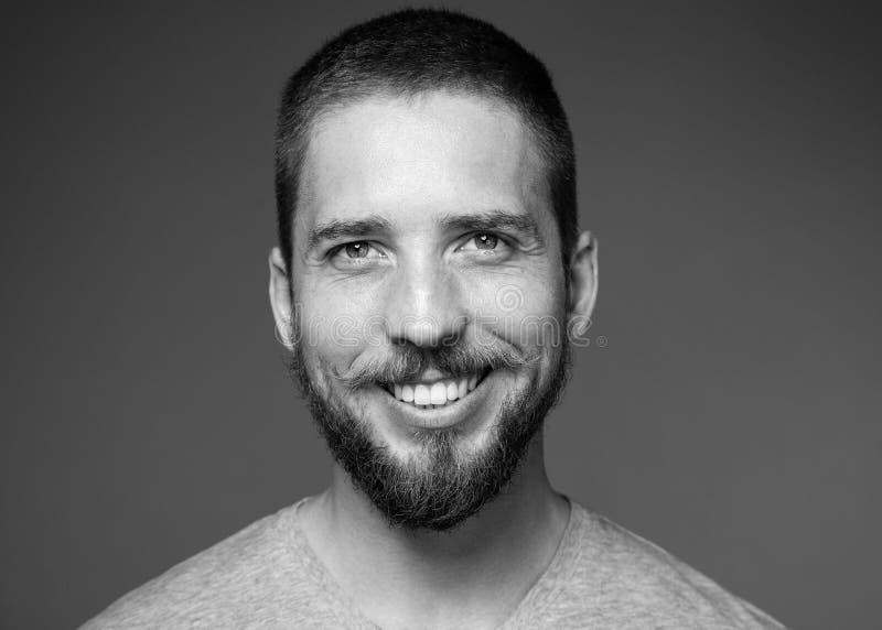Jonge mens met ruim het glimlachen stock afbeeldingen