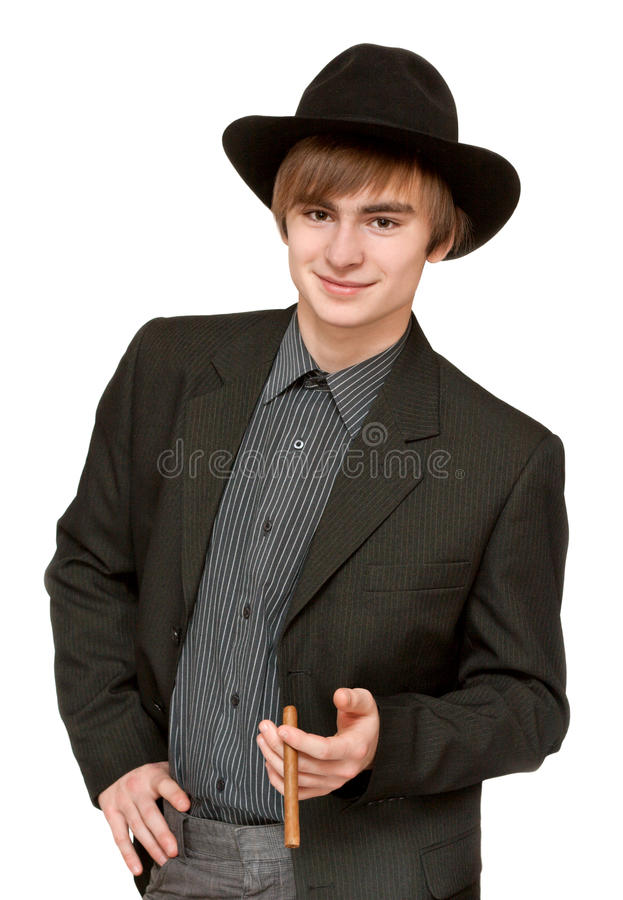 Jonge mens met sigaar in hoed stock afbeelding