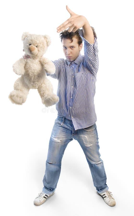 Jonge mens met teddy royalty-vrije stock afbeelding