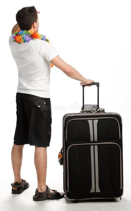 Jonge mens met zijn bagage stock foto