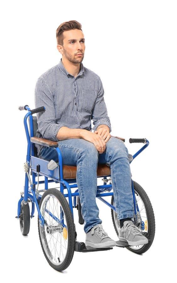 Jonge mens in rolstoel royalty-vrije stock afbeelding