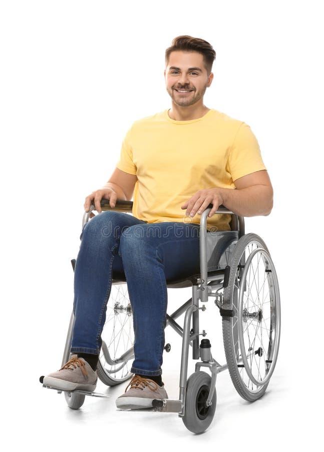 Jonge mens in rolstoel stock fotografie