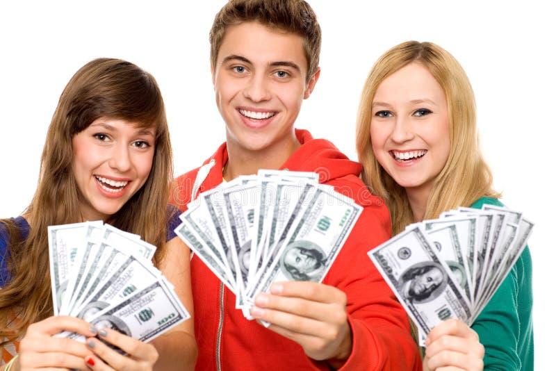 Jonge mensen die geld houden stock afbeelding