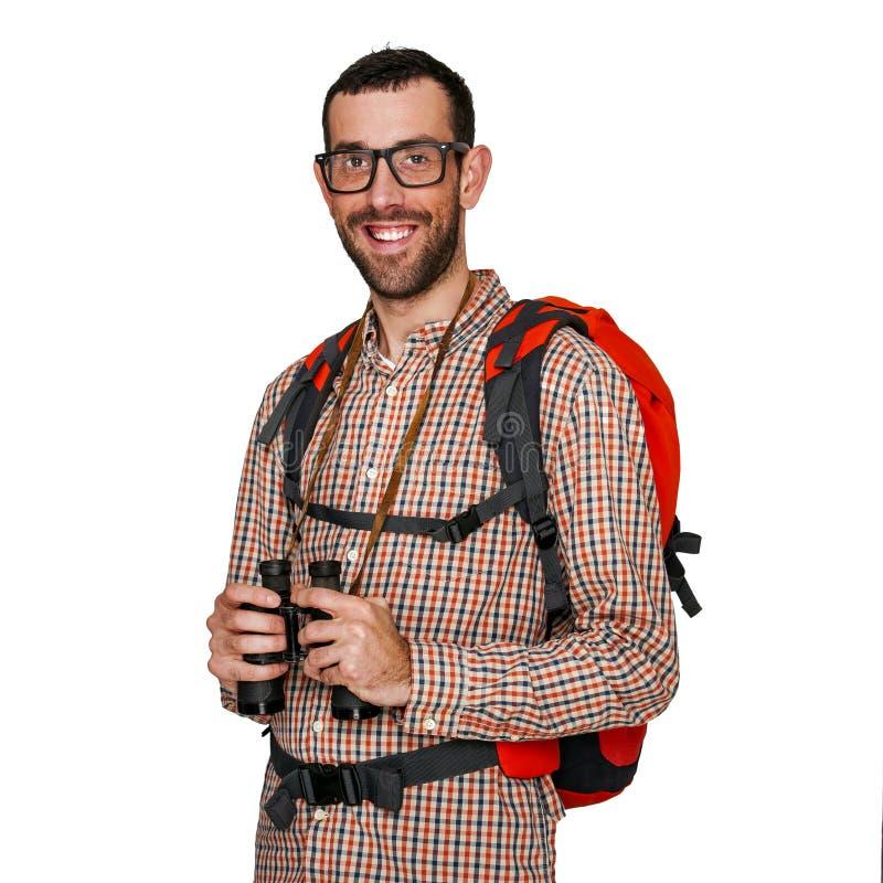 Jonge mensenwandelaar in reizigersoverhemd met een glimlachuitdrukking royalty-vrije stock foto
