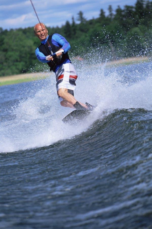 Jonge mensenwater het skiån stock afbeeldingen