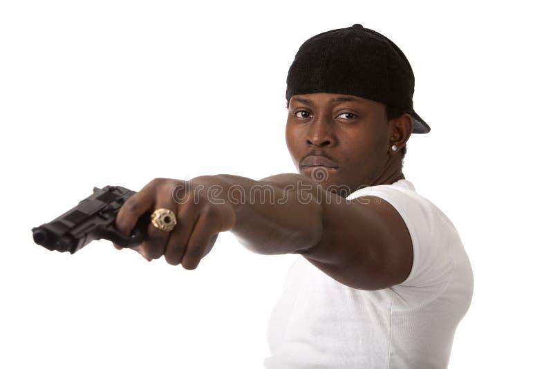 Jonge misdadiger met een kanon royalty-vrije stock afbeeldingen
