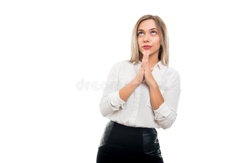 Jonge mooie bedrijfsvrouw die gebedgebaar maken stock fotografie