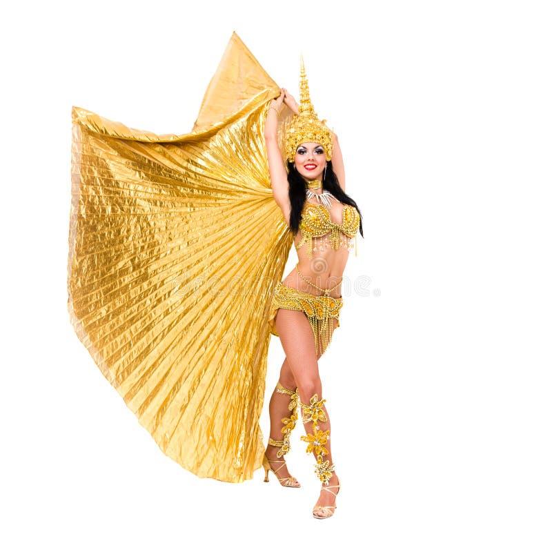 Jonge mooie buikdanser in een gouden kostuum stock afbeeldingen