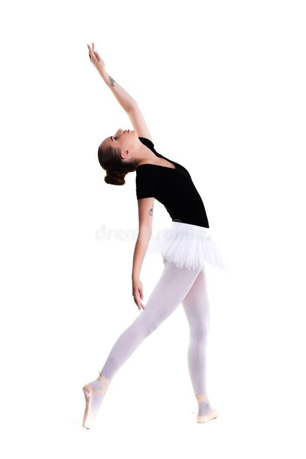 Jonge mooie die balletdanser over witte achtergrond wordt geïsoleerd stock afbeelding