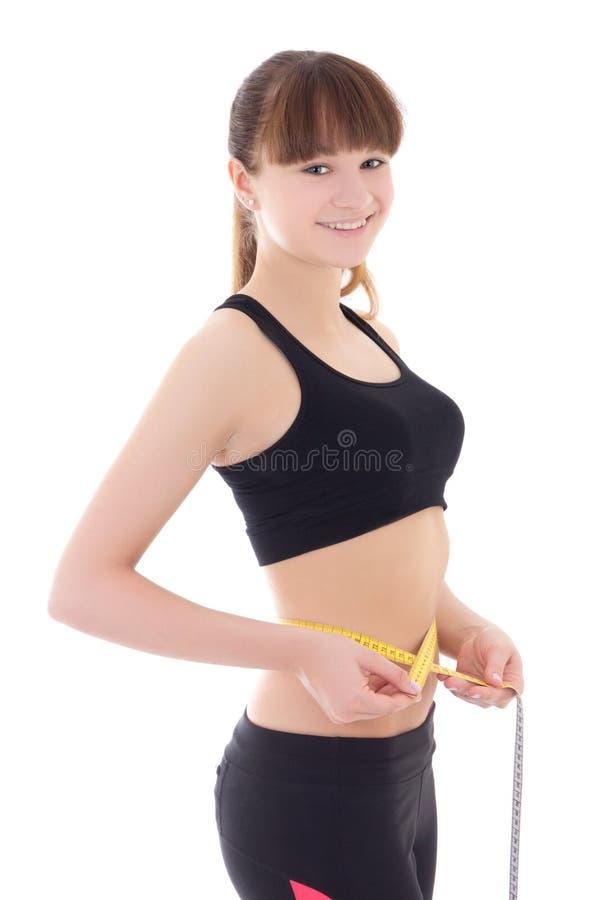 Jonge mooie slanke sportieve vrouw met geïsoleerde maatregelenband stock fotografie