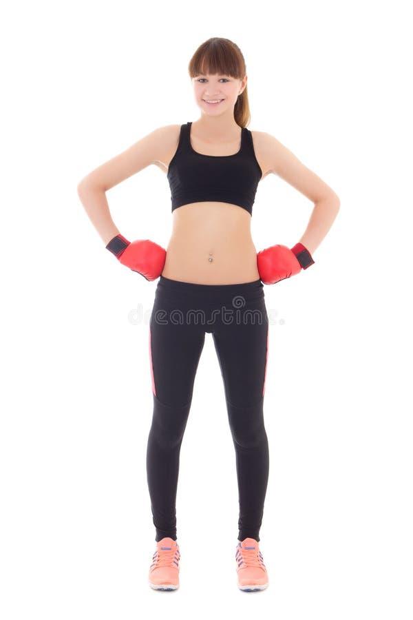 Jonge mooie sportieve die vrouw in bokshandschoenen op wit wordt geïsoleerd stock fotografie