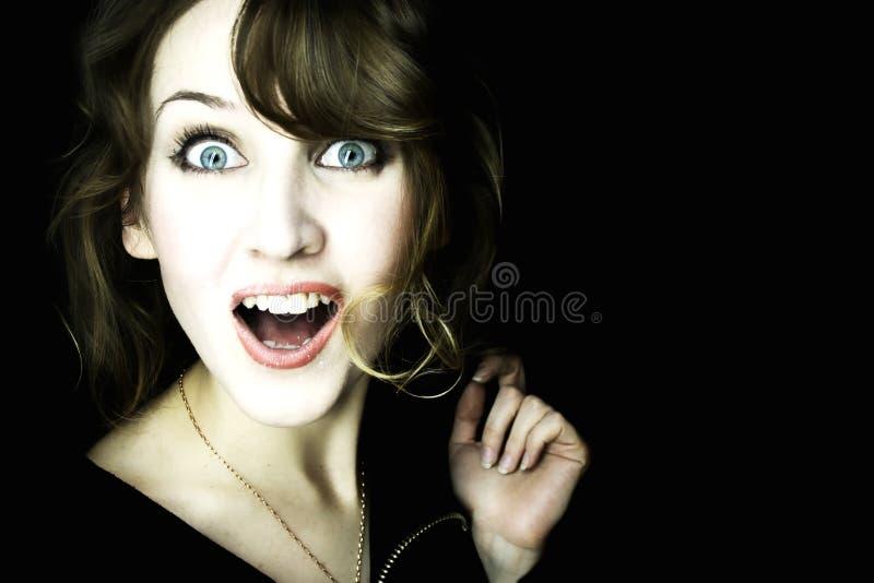 Jonge mooie verraste vrouw stock foto