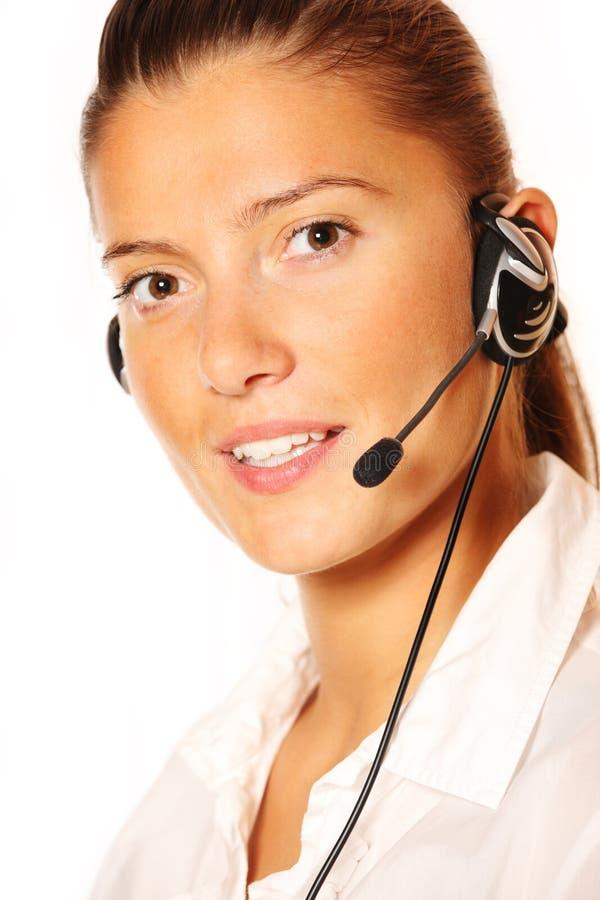 Jonge mooie vrouw in een call centre royalty-vrije stock foto