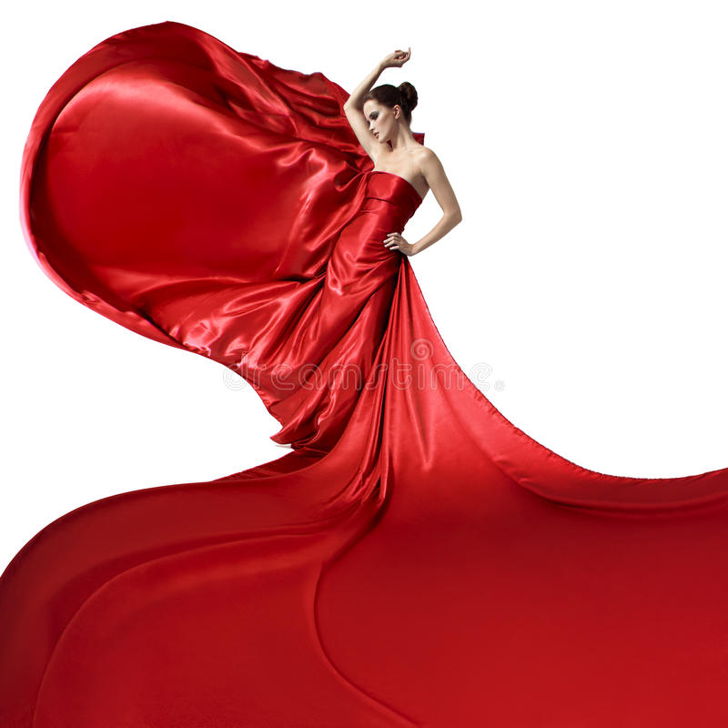 Jonge mooie vrouw in fladderende rode kleding Geïsoleerde stock foto's