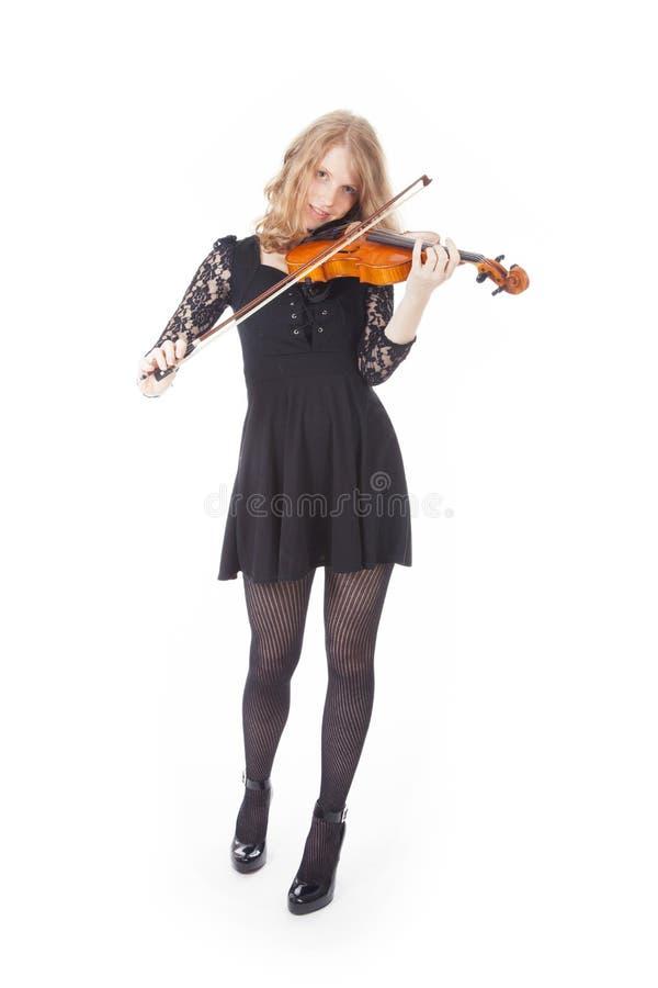 Jonge mooie vrouw het spelen viool royalty-vrije stock afbeeldingen