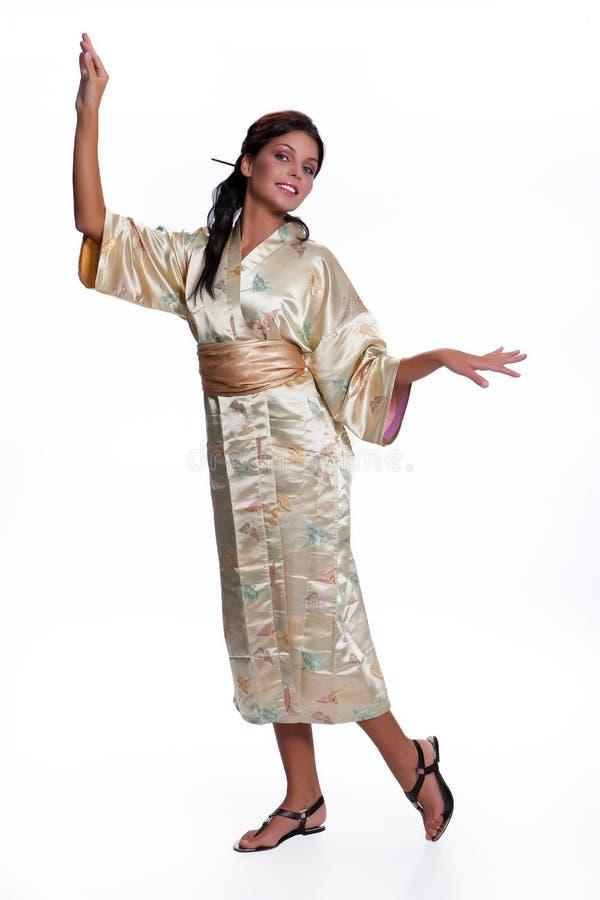 Jonge Mooie Vrouw in Japanse Nationale Kleding royalty-vrije stock foto