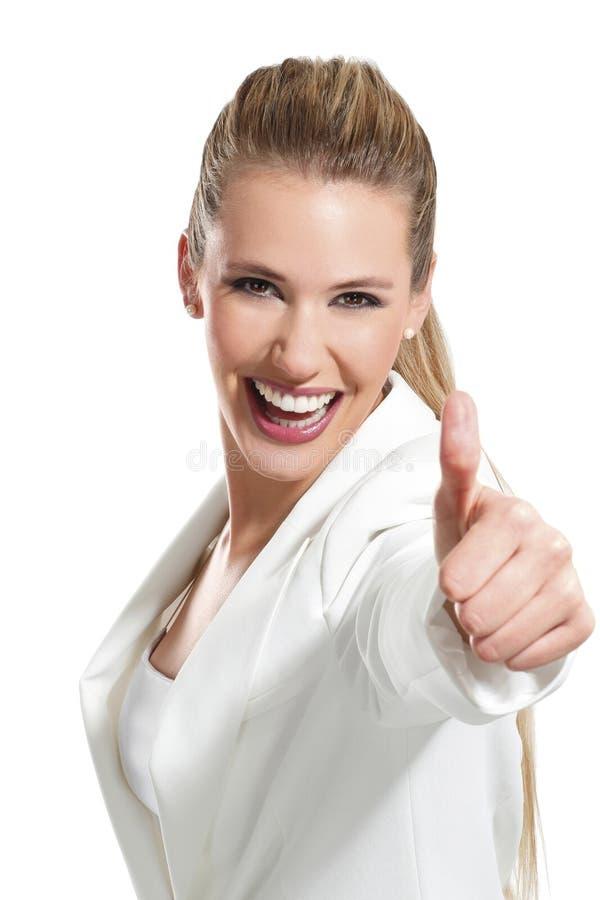 Jonge mooie vrouw met duimen omhoog op wit royalty-vrije stock fotografie