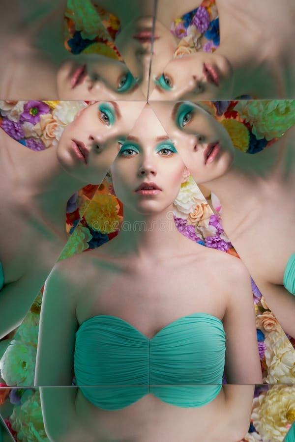 Jonge mooie vrouw met heldere colorfullmake-up op bloemachtergrond royalty-vrije stock fotografie