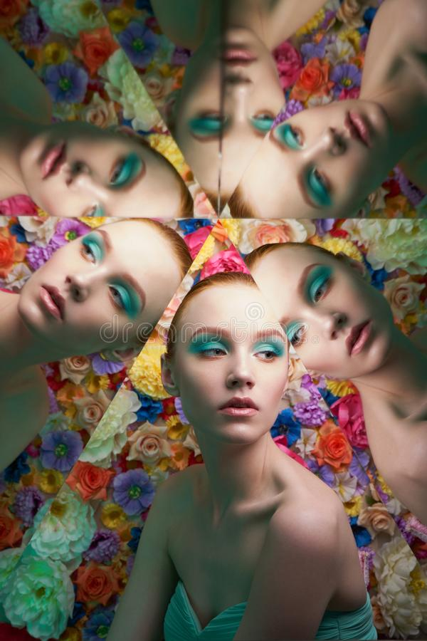 Jonge mooie vrouw met heldere colorfullmake-up op bloemachtergrond royalty-vrije stock afbeeldingen