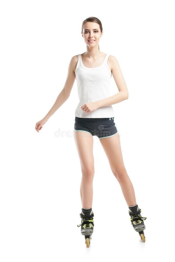 Jonge mooie vrouw op rolschaatsen royalty-vrije stock foto