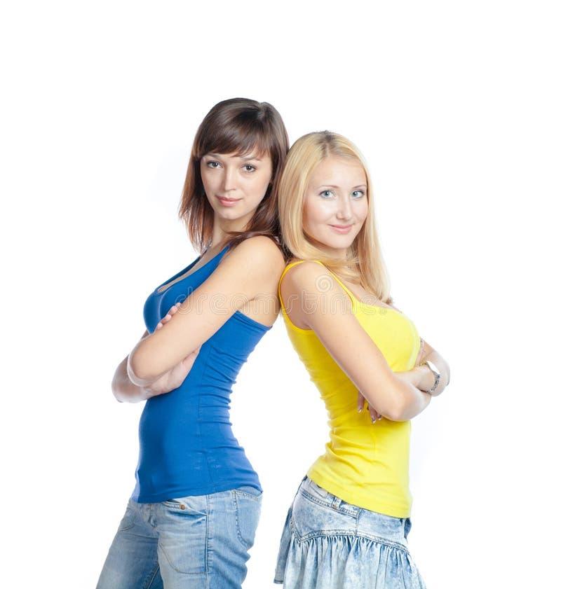 Jonge mooie vrouw twee op wit stock foto's