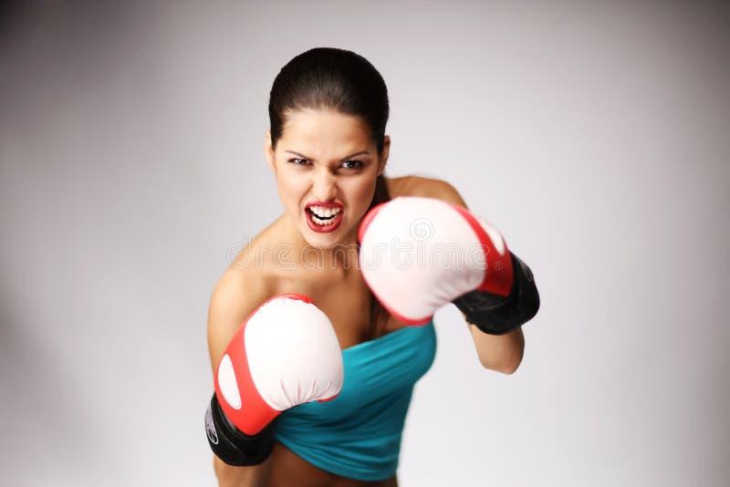 Jonge mooie vrouwen met bokshandschoenen. royalty-vrije stock foto