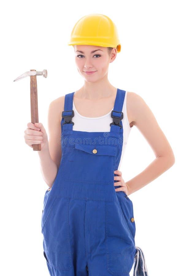 Jonge mooie vrouwenbouwer in blauwe overtrekken met hamerisol royalty-vrije stock foto's