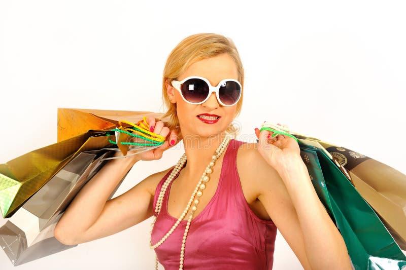 Jonge mooie winkelende vrouw met veel zakken royalty-vrije stock foto's