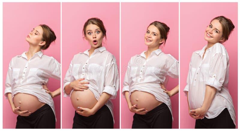 Jonge mooie zwangere vrouw die zich op roze achtergrond bevinden royalty-vrije stock afbeeldingen