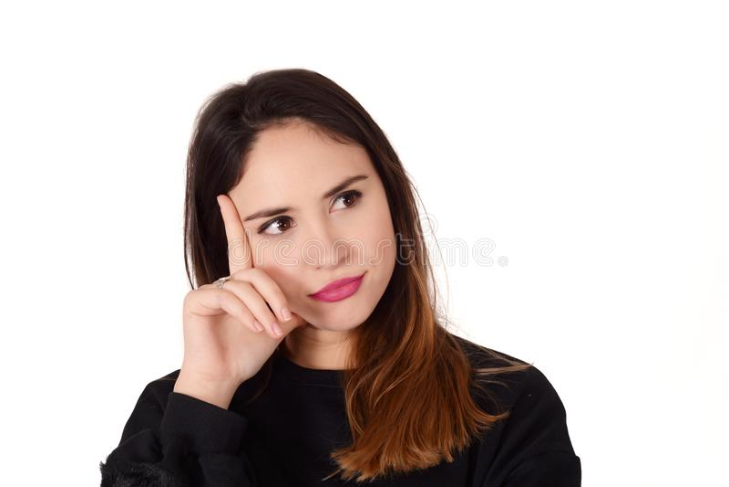 Jonge nadenkende vrouw met hand op haar chi royalty-vrije stock fotografie