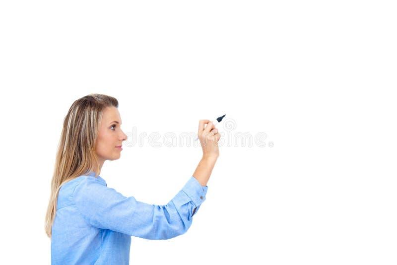 Jonge onderneemster die met pen schrijven stock afbeelding