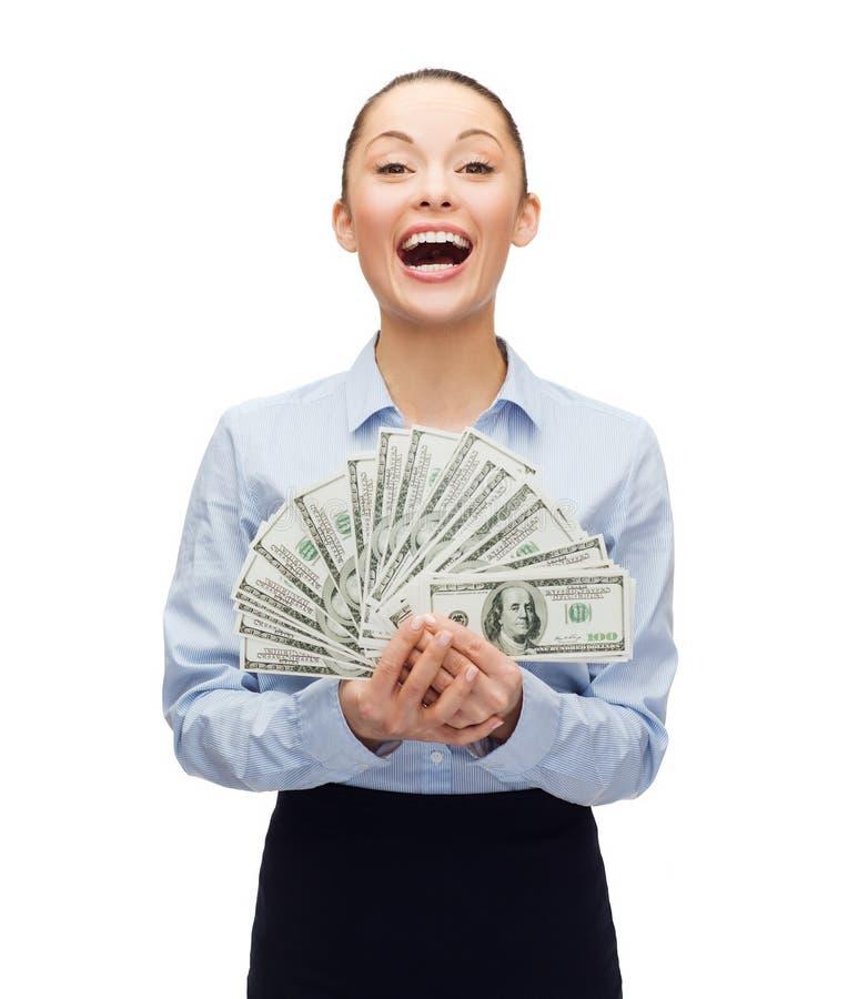 Jonge onderneemster met het geld van het dollarcontante geld royalty-vrije stock foto's