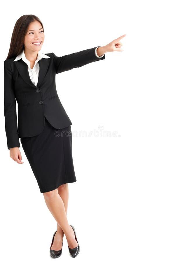 Jonge Onderneemster Pointing At Copyspace stock fotografie