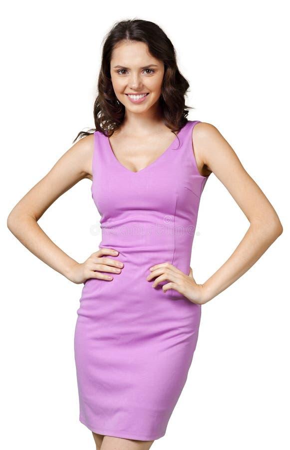 Jonge prachtige vrouw in lilac kleding royalty-vrije stock fotografie