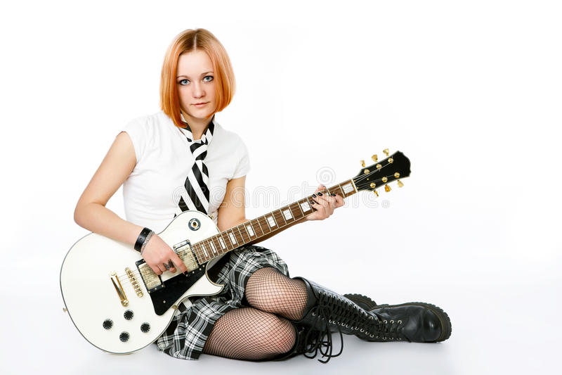 Jonge rotsster met een gitaar stock foto