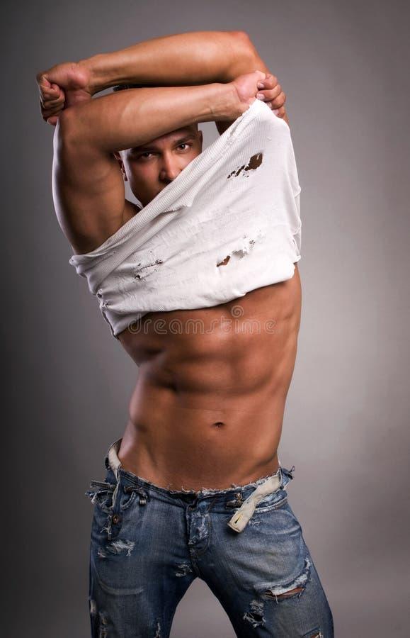 Jonge sexy mens. royalty-vrije stock afbeeldingen
