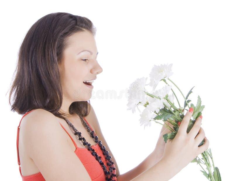 Jonge sexy vrouw met een witte bloem. stock afbeelding