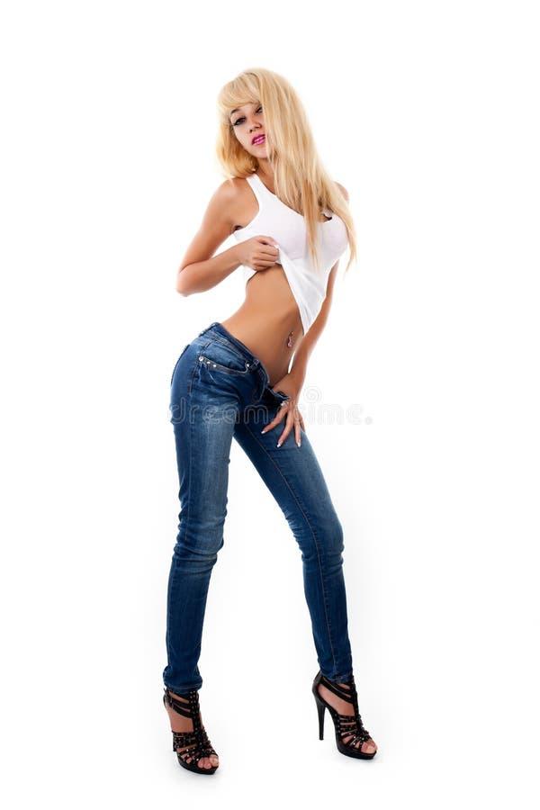 Jonge sexy vrouwen in jeans stock foto's