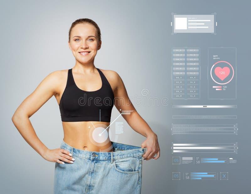 Jonge slanke sportieve vrouw in grote groottebroek stock afbeeldingen