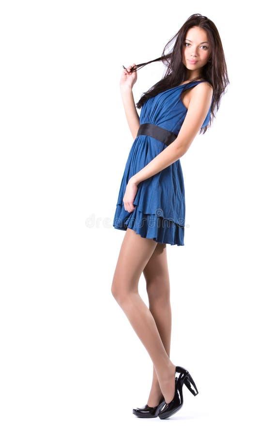 Jonge slanke vrouw in blauwe kleding stock afbeeldingen