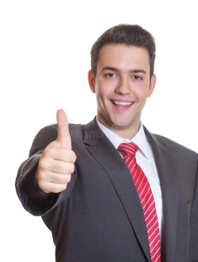 Jonge Spaanse zakenman die duim tonen upoung Spaanse zakenman royalty-vrije stock fotografie