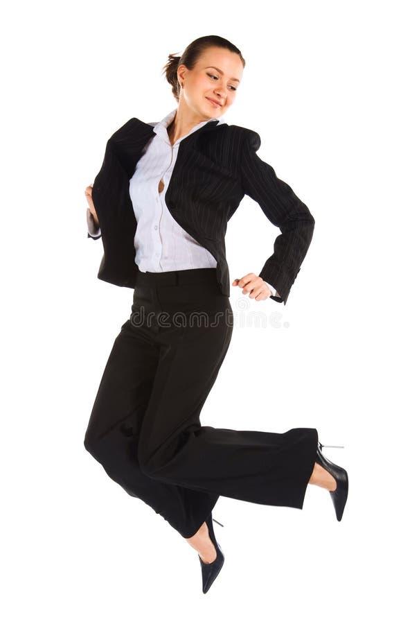 Jonge springende vrouwelijke beambte stock afbeeldingen