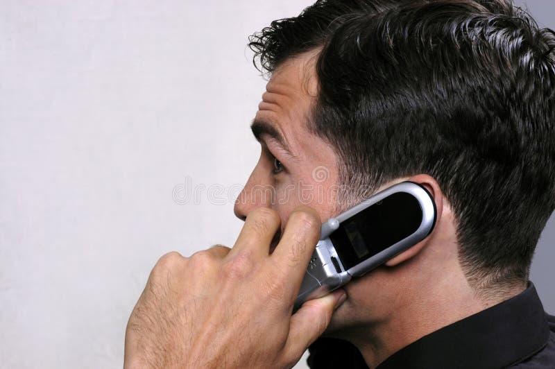 Jonge stafmedewerker op telefoon 2 royalty-vrije stock afbeeldingen