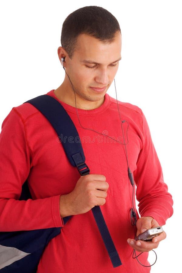 Jonge student het luisteren muziek stock afbeelding
