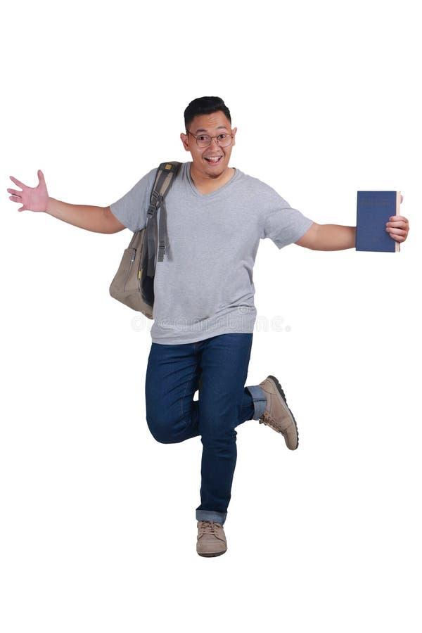 Jonge Student Standing Dancing Happy royalty-vrije stock foto