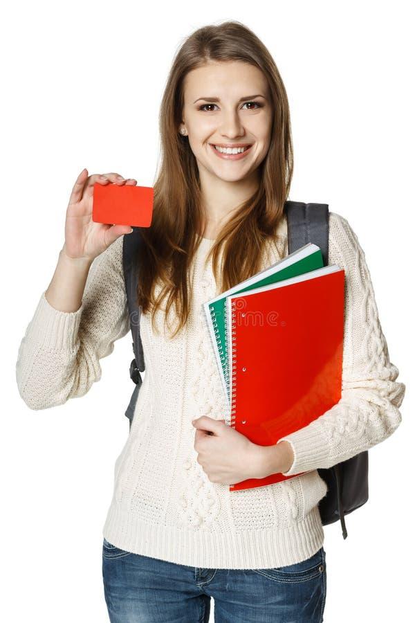Jonge studente die lege creditcard tonen stock afbeeldingen